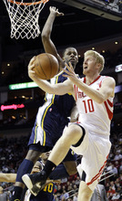 Houston Rockets' Chase Budinger (10) shoots while fouled by Utah Jazz's C.J. Miles, left, during the second quarter of an NBA basketball game, Sunday, Feb. 19, 2012, in Houston. (AP Photo/David J. Phillip)
