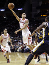 Houston Rockets' Kevin Martin (12) shoots as Utah Jazz's Al Jefferson, right, defends during the first quarter of an NBA basketball game, Sunday, Feb. 19, 2012, in Houston. (AP Photo/David J. Phillip)