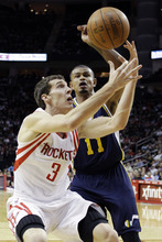 Utah Jazz's Earl Watson (11) knocks the ball loose from Houston Rockets' Goran Dragic (3) during the second quarter of an NBA basketball game, Sunday, Feb. 19, 2012, in Houston. (AP Photo/David J. Phillip)