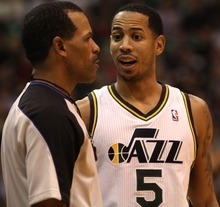 Rick Egan  | The Salt Lake Tribune   Utah Jazz point guard Devin Harris (5) has a few words with the referee, in NBA action in Salt Lake City, Monday, February 20, 2012.