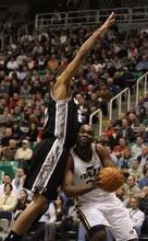 Rick Egan  | The Salt Lake Tribune   Utah Jazz power forward Paul Millsap (24)gets around San Antonio Spurs center Tim Duncan (21) in NBA action in Salt Lake City, Monday, February 20, 2012.