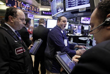 (AP Photo/Richard Drew) The milestone Tuesday came about two hours into the trading day. The Dow was above 13,000 for about 30 seconds, and for slightly longer at about 10 a.m. and 11:30 p.m. MST, but couldn't hold its gains. It finished up 15.82 points at 12,965.69.