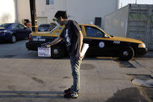 In this Dec. 16, 2011 photo, crew member Arthur Hong holds a clapboard while filming holiday movie trailers at the Maker Studios in Culver City, Calif. The $100 million investment by YouTube in 96 new channels starting in October has sparked a flurry of activity in Hollywood's independent producer community. At companies like Maker Studios, which received money for three new channels, the funds have turbo-charged an already teeming operation. (AP Photo/Jae C. Hong)