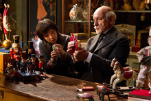 In this image released by Paramount Pictures, Asa Butterfield portrays Hugo Cabret, left, and Ben Kingsley plays Georges Méliès in a scene from