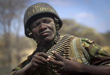 Kenyan army soldier Nicholas Munyanya, wearing a helmet on which is written in Kiswahili