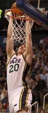 Rick Egan  | The Salt Lake Tribune   Utah Jazz small forward Gordon Hayward (20) dunks the ball, in NBA action in Salt Lake City, Monday, February 20, 2012.