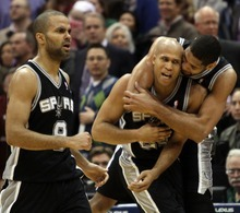 Rick Egan  | The Salt Lake Tribune   San Antonio Spurs point guard Tony Parker (9), San Antonio Spurs small forward Richard Jefferson (24) and San Antonio Spurs center Tim Duncan (21) celebrate as Jefferson sunk a three-point shot, with just seconds left in the game, in NBA action in Salt Lake City, Monday, February 20, 2012.