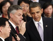 File photo | The Associated Press President Barack Obama is joined in January 2011 by former U.S. Ambassador to China and former Utah Gov. Jon Huntsman Jr. at a town hall-style event with Chinese youths at the Museum of Science and Technology in Shanghai. Utahns have donated about as much to Obama's campaign as they have to Huntsman.