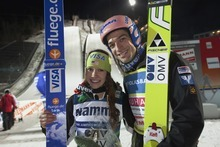 The women's winner Sarah Hendrickson of USA and the men's winner Andreas Kofler celebrate after FIS World Cup Ski Jumping event in Lillehammer, Norway Saturday Dec. 3, 2011.    (AP Photo/Geir Olsen/Scanpix Norway)