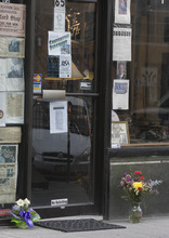 Paul Fraughton | The Salt Lake Tribune. Flowers are left in front of the Oxford Shop in downtown Salt Lake city in honor of the store's owner Dick Wirick, who was killed this morning when he was struck by a bus.  Tuesday, February 21, 2012