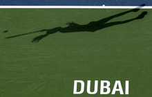 The shadow of Jelena Jankovic from Serbia as she serves the ball to Flavia Pennetta from Italy during the third day of Dubai Duty Free Tennis Championships in Dubai, United Arab Emirates, Wednesday, Feb. 22, 2012. (AP Photo/Hassan Ammar)