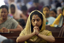 Indian Christians offer prayers during a mass in observance of Ash Wednesday at a Catholic church in Hyderabad, India, Wednesday, Feb. 22, 2012. Ash Wednesday marks the beginning of Lent, a time when Christians prepare for Easter through acts of penitence and prayer. (AP Photo/Mahesh Kumar A.)