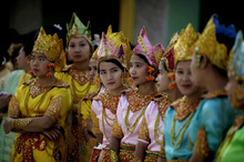 Myanmar girls in ceremonial dresses wait to take part in the 2600th anniversary celebrations of Shwedagon Pagoda in Yangon, Myanmar, Wednesday, Feb. 22, 2012. (AP Photo/Altaf Qadri)