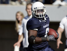 USU running back Robert Turbin is hoping to  impress NFL scouts at this week's draft combine in Indianapolis. Aggie linebacker Bobby Wagner will join him in Indy. Jim Urquhart  /  The Salt Lake Tribune