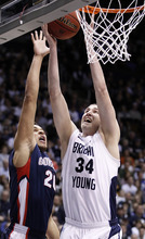 BYU's Noah Hartsock, right, scores on Gonzaga's Elias Harris during the second half of an NCAA college basketball game in Provo, Utah, Thursday, Feb. 2, 2012. BYU beat Gonzaga 83-73. (AP Photo/George Frey)