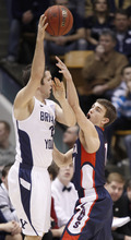 Gonzaga's David Stockton, right applies pressure to  BYU's Craig Cusick during the first half of an NCAA college basketball game in Provo, Utah, Thursday, Feb. 2, 2012. (AP Photo/George Frey)