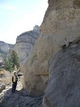 A Utah Department of Transportation worker stands next to a huge boulder dislodged by a landslide in October on State Road 14 near Cedar City. Courtesy UDOT