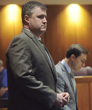 Gabe Watson, left, stands during a break in his capital murder trial at the Mel Bailey Criminal Justice Center in Birmingham, Ala., Thursday, Feb. 23, 2012. An Alabama judge acquitted Watson, accused of drowning his newlywed wife during a honeymoon diving trip to Australia. (AP Photo/ The Birmingham News, Tamika Moore)
