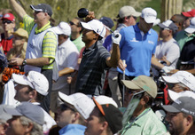 Tiger Woods reacts to his tee shot on the sevent hole while playing Nick Watney at the Match Play Championship golf tournament, Thursday, Feb. 23, 2012, in Marana, Ariz. Woods lost 1-up. (AP Photo/Eric Risberg)