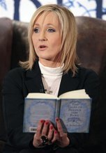 FILE - A Thursday Dec. 4, 2008 photo from files showing author JK Rowling reading to around 200 schoolchildren at a tea party in the Parliament Hall Edinburgh Thursday Dec, 4, 2008, where she read passages from her new book