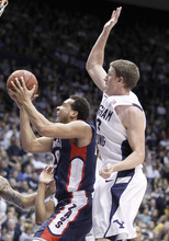 Gonzaga's Elias Harris, left, shoots past BYU's Brock Zylstra during the first half of an NCAA college basketball game in Provo, Utah, Thursday, Feb. 2, 2012. (AP Photo/George Frey)