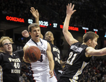 Western Michigan's, from left, Matt Stainbrook (40), Mike Douglas (5) and Shayne Whittington (21) defend against Gonzaga's Kevin Pangos (4) as he looks to pass in the second half of an NCAA college basketball game, Saturday, Nov. 26, 2011, in Spokane, Wash. Gonzaga won 78-58. (AP Photo/Jed Conklin)