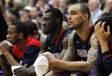 Gonzaga's Robert Sacre watches his team play against San Francisco during the second half of an NCAA college basketball game in San Francisco, Saturday, Feb. 18, 2012. San Francisco won 66-65. (AP Photo/Mathew Sumner)