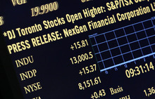 (AP Photo/Richard Drew) A board on the floor of the New York Stock Exchange shows the Down Jones Industrial average as it crosses 13,000 for brief time Friday. Had it held, it would have been the first time since May 2008 the index closed at or above the milestone.
