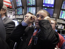 (AP Photo/Richard Drew) After a day of ups and downs, the Dow closed Friday at 12,982.85, down 1.74 points.