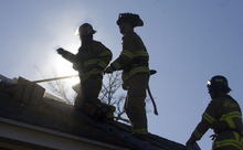 Al Hartmann  |  The Salt Lake Tribune Firefighters with Salt Lake City Fire Department and Unified Fire cut ventilation holes in roofs as part of their fire training on a parcel of vacant houses and apartments at 1327 E. 2100 South on Friday, Feb. 24.   The developer allowed the agencies to use the vacant buildings to train with before their demolition.   A 29-unit apartment building with a bakery or butcher plus office space called