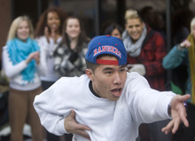 Al Hartmann  |  The Salt Lake Tribune May Nguyen of Boise, Idaho, shows a few of his dance moves while waiting to audition for