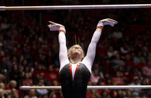 Trent Nelson  |  The Salt Lake Tribune Utah's Hailee Hansen performs on the bars as the University of Utah hosted Georgia at the Huntsman Center on Friday, Feb. 3, 2012, in Salt Lake City.
