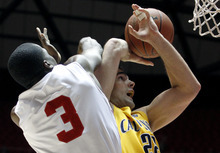 California forward Harper Kamp (22) loses the ball against Utah guard Anthony Odunsi (3) during the first half of an NCAA college basketball game Thursday, Feb. 23, 2012, in Salt Lake City. (AP Photo/Jim Urquhart)