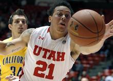 Utah forward Javon Dawson (21) chases a ball ahead of California forward Robert Thurman (34) during the first half of an NCAA college basketball game on Thursday, Feb. 23, 2012, in Salt Lake City. (AP Photo/Jim Urquhart)