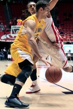 California forward Harper Kamp, front, drives around Utah forward Dijon Farr (10) during the second half of an NCAA college basketball game on Thursday, Feb. 23, 2012, in Salt Lake City. California won 60-46. (AP Photo/Jim Urquhart)