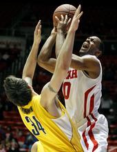 Utah guard Chris Hines (0) shoots against California forward Robert Thurman (34) during the second half of an NCAA college basketball game on Thursday, Feb. 23, 2012, in Salt Lake City.  California won 60-46. (AP Photo/Jim Urquhart)