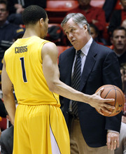 California head coach Mike Montgomery talks to guard Justin Cobbs (1) during the second half of an NCAA college basketball game against Utah Thursday, Feb. 23, 2012, in Salt Lake City. California won 60-46. (AP Photo/Jim Urquhart)