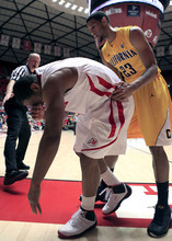 California guard Allen Crabbe (23) checks on Utah guard Chris Hines, left, after he was injured during the first half of an NCAA college basketball game on Thursday, Feb. 23, 2012, in Salt Lake City. California won 60-46. (AP Photo/Jim Urquhart)