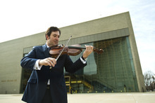 Chris Detrick  |  The Salt Lake Tribune Utah Symphony principal violist Brant Bayless poses for a portrait at Abravanel Hall. Bayless will be featured as a guest artist on an upcoming Utah Symphony concert, performing the regional premiere of a recent work by Japanese composer Toru Takemitsu,