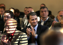 Scott Sommerdorf  |  The Salt Lake Tribune              Former lobbyist Jack Abramoff applauds as Bert and Kathy Smith were introduced. The Smiths were instrumental in bringing Abramoff to the Capitol to speak to the Utah Rural Caucus, Friday February 24, 2012.