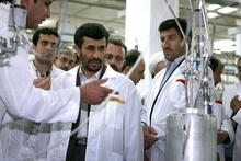 Iranian President Mahmoud Ahmadinejad, center, listens to a technician during his visit of the Natanz Uranium Enrichment Facility some 200 miles (322 kilometers) south of the capital Tehran, Iran. For the first time in nearly two decades of escalating tensions over the Iranian nuclear program, it appears that world leaders are genuinely concerned that an Israeli military attack on the Islamic Republic could be imminent, an action that many fear might trigger war, terrorism and global economic havoc. (AP Photo/Iranian Presidents office, File)