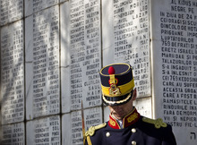 A honor guard soldier stands during a ceremony  at a Jewish cemetery in Bucharest, Romania, Friday, Feb. 24, 2012, next to a monument bearing the names of Jews killed 70 years ago when the SS Struma, the ship they were on as refugees on the way to Palestine, was sunk by a Soviet torpedo in the Black Sea leading to the death of all but one of the 779 people on board.At a time when Turkey welcomes Syrians fleeing violence, the anniversary Friday of the deaths of more than 750 Jewish refugees whose boat was abandoned by Turkish officials in World War II was a reminder of the tension between pragmatic and humanitarian impulses.(AP Photo/Vadim Ghirda)