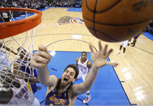 Los Angeles Lakers forward Pau Gasol, of Spain, releases a shot in front of Oklahoma City Thunder center Kendrick Perkins (5) and guard Russell Westbrook (0) in the second quarter of an NBA basketball game in Oklahoma City, Thursday, Feb. 23, 2012. (AP Photo/Sue Ogrocki)