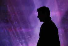 The silhouette of actor Tom Cruise is shown during rehearsals for the 84th Academy Awards show Friday, Feb 24, 2012 in Los Angeles.  The Academy Awards will be held on Sunday. (AP Photo/Chris Carlson)