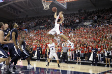 Bringman Young's defense can only watch as Gonzaga's Elias Harris (20) goes for the dunk as teammate Kevin Pangos (4) watches, in the second half of an NCAA college basketball game, Thursday, Feb. 23, 2012, in Spokane, Wash. Gonzaga beat BYU 74 to 63. (AP Photo/Jed Conklin)