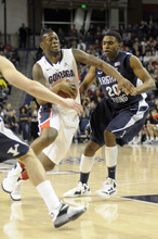 Bringman Young's Anson Windor (20) defends Gonzaga's Gary Bell Jr., in the first half of an NCAA college basketball game, Thursday, Feb. 23, 2012, in Spokane, Wash. (AP Photo/Jed Conklin)