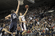 Bringman Young's Noah Hartsock (34) defends Gonzaga's Kevin Pangos as he drives for a layup, in the first half of an NCAA college basketball game, Thursday, Feb. 23, 2012, in Spokane, Wash. (AP Photo/Jed Conklin)