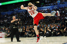 Houston Rockets' Chase Budinger follows through on a blindfolded dunk in honor of former Phoenix Suns' Cedric Ceballos, who performed a blindfolded dunk in 1992, during the NBA basketball All-Star Slam Dunk contest, Saturday, Feb. 25, 2012, in Orlando, Fla. (AP Photo/Lynne Sladky)
