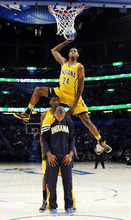 Indiana Pacers' Paul George jumps over two teammates during the NBA basketball All-Star Slam Dunk Contest in Orlando, Fla. Saturday, Feb. 25, 2012. (AP Photo/Jeff Haynes, Pool)