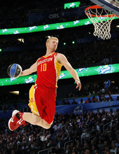 Houston Rockets' Chase Budinger (10) performs his attempt during the NBA basketball All-Star Slam Dunk Contest in Orlando, Fla., Saturday, Feb. 25, 2012. (AP Photo/Lynne Sladky)